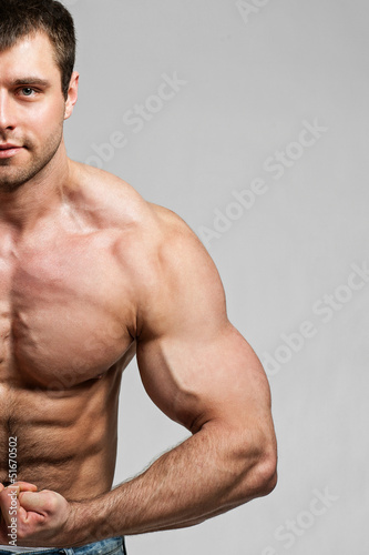 Bodybuilder shows his biceps