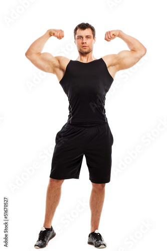 Bodybuilder in fitwear posing isolated
