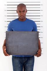 african man police mug shot