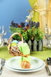Easter table setting on color background