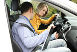 Learner driver student driving car with instructor