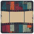 Film strip in grunge frame on colorful seamless wooden backgroun