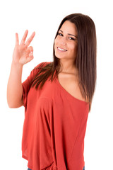 Beautiful woman smiling and showing OK sign