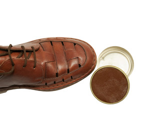 brown leather shoe with shoe polish paste, isolated