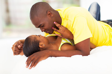 young african couple in bed