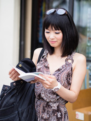 a young asian woman traveling