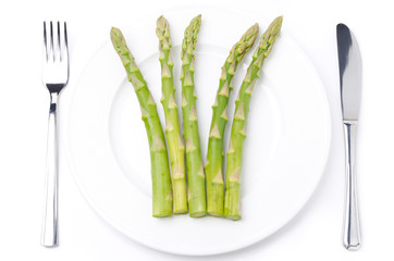 dietetic food - asparagus on a plate, concept, isolated on white
