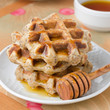 homemade waffles with maple syrup and poppy