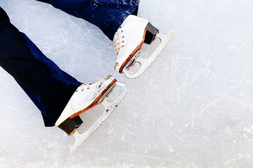 white leather skates on ice