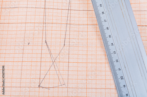 metal ruler at graph paper