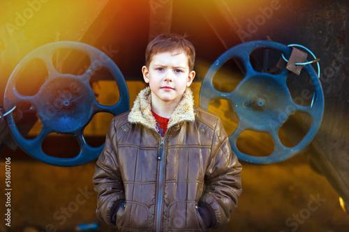sunlight Boy homeless on street freezing close to railway carria