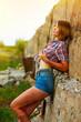 sunlight blonde young model woman in cowboy shirt and shorts, hi