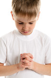 Little boy praying - closeup