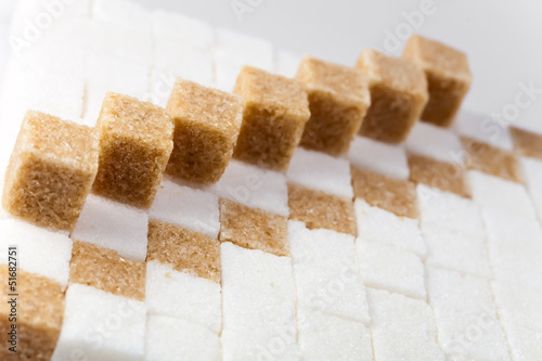 Cubes of not refined reed sugar and white sugar