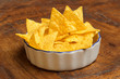 bowl of tortilla chips on wooden background
