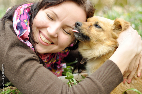 Attractive young girl with a puppy outdoors