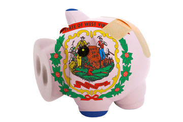 closed piggy rich bank with bandage in colors flag of american s