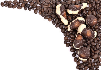 Chocolate candy with coffee beans on a white background