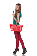 Happy shopping female holding blank credit card and red cart