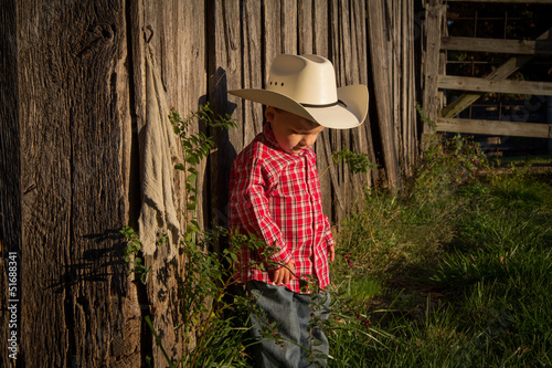 Little Farmer Next to Barn