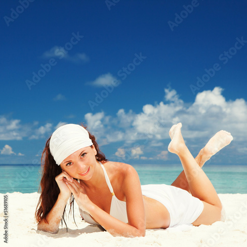 Cute woman relaxing on the beach