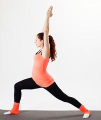 pretty Pregnant woman practicing yoga