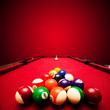Billards pool game. Color balls in triangle, aiming at cue ball