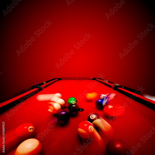 Billards pool game. Breaking the color ball from triangle