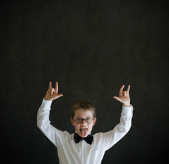 Education rocks boy dressed up as businessman