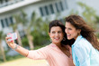 Women taking a picture with the phone