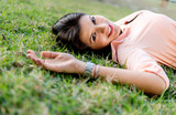 Beautiful woman lying outdoors