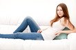 brunette woman lying on the couch in living room