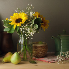 Still life with sunflower bouquet on wooden table