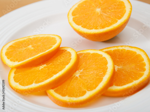Plate of juicy and delicious sliced navel orange