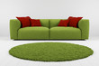 Green sofa with carpet closeup