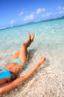 Closeup of woman body bathing in Caribbean sea