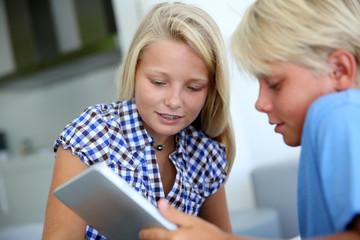 Teens websurfing on internet with digital tablet