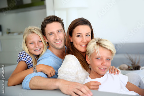 Portrait of family relaxing in sofa