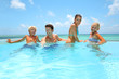 Quadro Family of four bathing in swimming pool