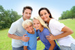 Portrait fo happy family standing in natural landscape