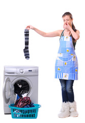 A housewife holding a male sock and her nose