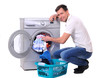 young male next to a washing machine