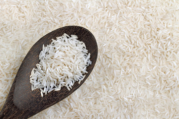 wooden spoon with basmati rice