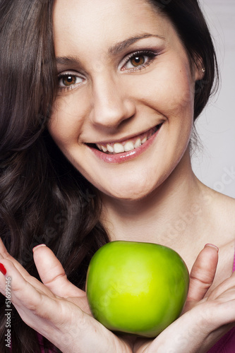 Young happy woman with an apple