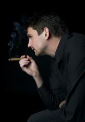 Young man smoking a cigar