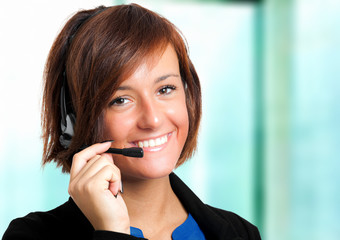 Female call center employee wearing a headset