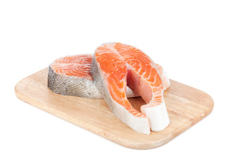 Salmon steaks on cutting board
