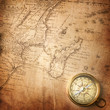 old compass on vintage map 1737