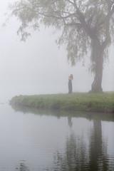 Single female in the mist