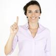 Geschäftsfrau zeigt mit ihrem Finger die Zahl eins an